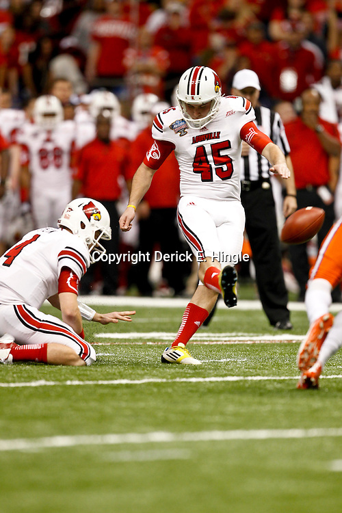 Jan 2, 2013; New Orleans, LA, USA; Louisville Cardinals punter John Wallace (45) kicks a field goal during the second quarter of the Sugar Bowl against the Florida Gators at the Mercedes-Benz Superdome.  Mandatory Credit: Derick E. Hingle-USA TODAY Sports