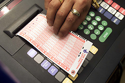 Pictures of people doing the lottery on the day Camelot lost their bid to keep the lottery in 2001. August 23, 2000. Photo by Andrew Parsons/i-Images.