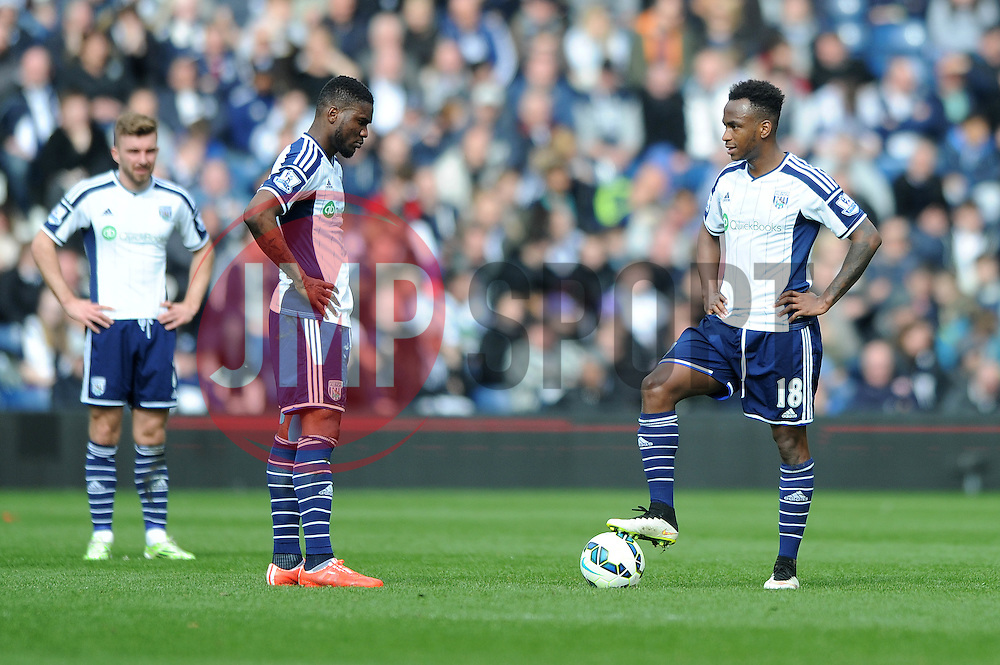 West Bromwich Albion's Saido Berahino and West Bromwich Albion's Craig Gardner cut dejected figures as they wait to restart the game from kick off - Photo mandatory by-line: Dougie Allward/JMP - Mobile: 07966 386802 - 04/04/2015 - SPORT - Football - West Bromwich - The Hawthorns - West Bromwich Albion v QPR - Barclays Premier League