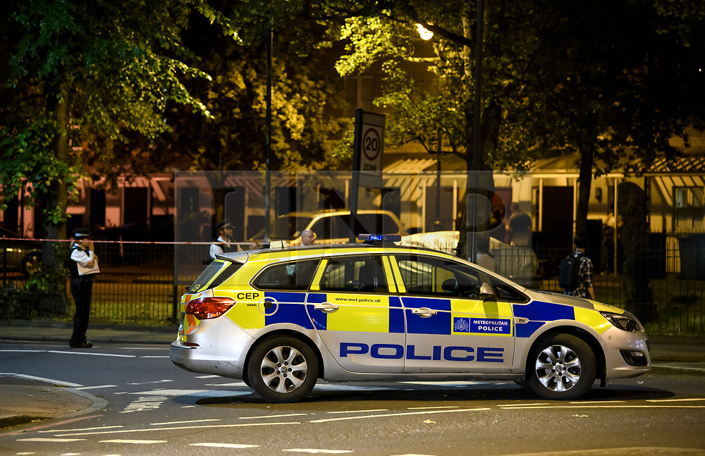 © Licensed to London News Pictures. 02/06/2018. London, UK. Police at the scene where a man has reportedly been shot in the face in Peckham, south London. Police said a man was found with gunshot injuries and has been rushed to hospital. Another man was also found injured nearby. Photo credit: Ben Cawthra/LNP