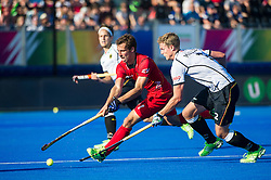 Belgium's Florent Van Aubel is tackled by Mathias Muller of Germany. Belgium v Germany - Unibet EuroHockey Championships, Lee Valley Hockey & Tennis Centre, London, UK on 22 August 2015. Photo: Simon Parker