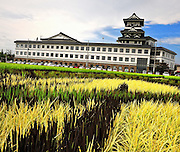 """Rice field Art or Tambo Art.<br /> In northern Japan the small village of Inakadate plants five different varieties of rice all different colours to produce.   """"Rice field art""""<br /> <br />  This photo shows the viewing tower as seen from the rice field in autumn with white, green and black rice.<br /> <br /> This is an annual event and attracts many thousands of tourists. Every year in autumn they have a different subject matter to be viewed. <br /> <br />  The design is done by an artist and then in a computer the design is calculated and adjusted to what it would look like when it is viewed from the town hall watch tower. Then the design is marked out in the rice fields."""
