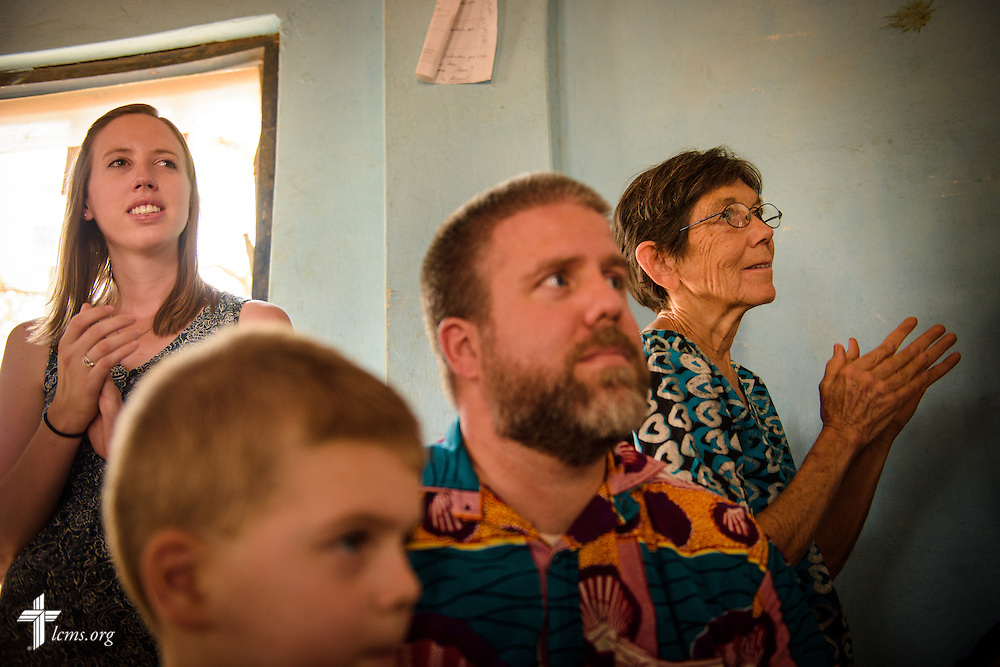 Molly Christensen, The Rev. Micah Wildauer and his son Sam, and Valerie Stonebreaker, LCMS missionaries to Togo, listen to introductions following a Bible study at the Lutheran Church of Togo in Lokpano on Monday, Feb. 13, 2017, in Lokpano, Togo. LCMS Communications/Erik M. Lunsford