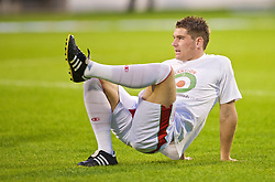 PODGORICA, MONTENEGRO - Wednesday, August 12, 2009: Wales' Sam Vokes warms-up wearing a shirt in support of former captain John Hartson who is battling against cancer, and to promote awareness of men's health issues with web site checkemlads.com, before an international friendly match against Montenegro at the Gradski Stadion. (Photo by David Rawcliffe/Propaganda)