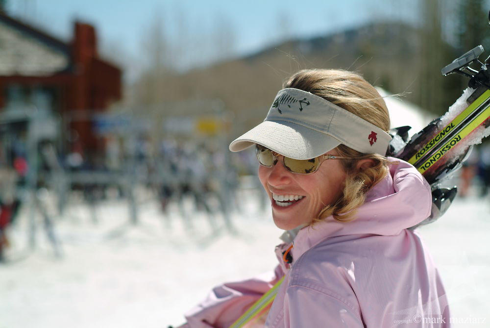 Jen with skis on her shoulder at Red Pine Lodge, The Canyons, Park City, Utah USA