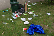 Raided by urban foxes are plastic plates, bottles, cutlery and party balloons remnants of a birthday celebration in Ruskin Park in Lambeth, on 21st August 2019, in London, England.