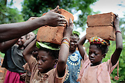 In the village of Zemio in the middle of the jungle, refugee children carry bricks into the village to earn money for teachers to educate them in their makeshift camp. several thousand refugees have sought refuge in the village due to fighting between LRA and goverment soldiers in the area.The central African rep. has some of the world's worst child welfare indicators. The infant mortality rate is 112, and out of 1,000 children born in CAR, 171 will die before reaching the age of five. The five main child killers in CAR are malaria, diarrhoea, acute respiratory infections, malnutrition and measles – all preventable diseases. The Accelerated Child Survival and Development Strategy UNICEF is implementing aims to reach every newborn and child in every district with a set of priority interventions. Evidence shows that there are a number of known and affordable interventions that if implemented fully could prevent 63 per cent of current childhood mortality.