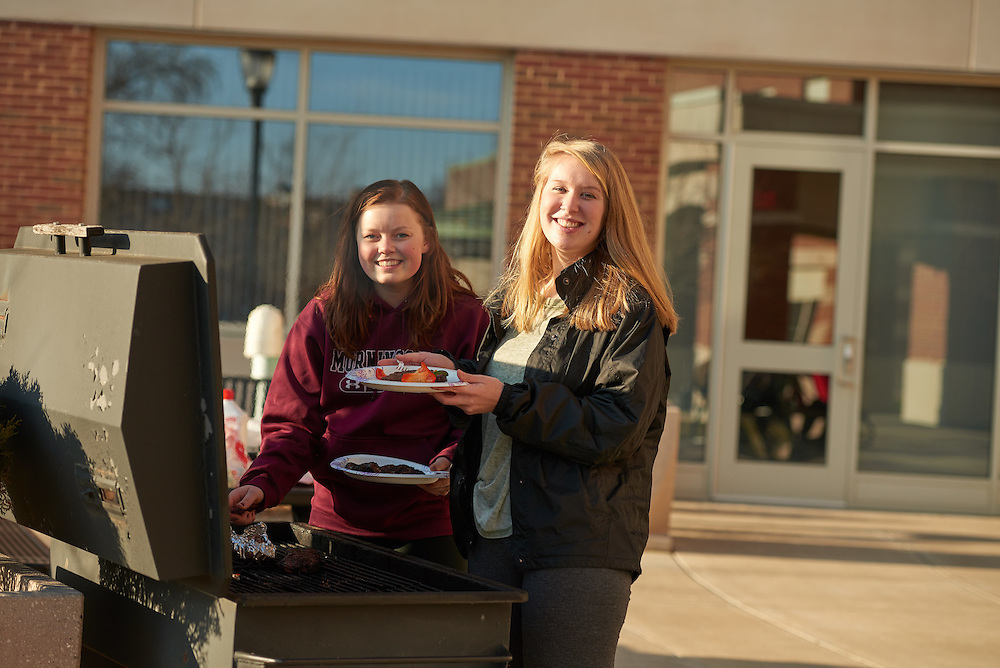 Activity; Playing; Relaxing; Socializing; Location; Outside; People; Student Students; UWL UW-L UW-La Crosse University of Wisconsin-La Crosse; Spring; March; Time/Weather; evening; Type of Photography; Candid; grilling; Campus Life