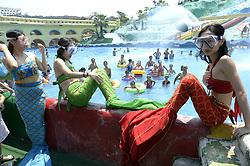 August 21, 2017 - Chongqin, China - Women wearing mermaid costumes enjoy the cool at the swimming pool in southwest China's Chongqing. (Credit Image: © SIPA Asia via ZUMA Wire)