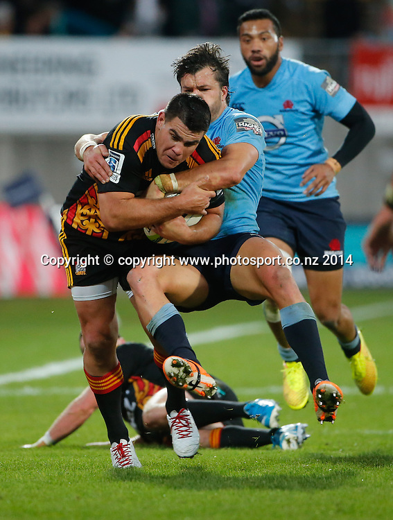 Chiefs Dwayne Sweeney is tackled. Super Rugby, Chiefs v Waratahs, Yarrow Stadium, New Plymouth, New Zealand. Saturday, 31 May, 2014. Photo: John Cowpland / photosport.co.nz