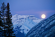 Moon rising over the Rocky Mountains, Canada, Banff