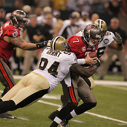 2008 September 7: New Orleans Saints defensive end Charles Grant (94) sacks Tampa Bay Buccaneers quarterback Jeff Garcia (7) during the first half of their game at the Louisiana Superdome in New Orleans, LA.