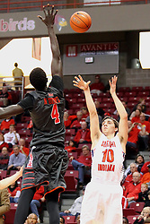 "08 November 2015: Daouda ""David"" Ndoaye (4) looks to block a shot by Jacob Norman(10). Illinois State Redbirds host the Southern Indiana Screaming Eagles and beat them 88-81 in an exhibition game at Redbird Arena in Normal Illinois (Photo by Alan Look)"