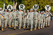 """11 NOVEMBER 2013 - PHOENIX, AZ: The 158th Infantry Regiment Band of the Arizona Army National Guard marches in the Phoenix Veterans Day Parade. The Phoenix Veterans Day Parade is one of the largest in the United States. Thousands of people line the 3.5 mile parade route and more than 85 units participate in the parade. The theme of this year's parade is """"saluting America's veterans.""""     PHOTO BY JACK KURTZ"""