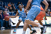 San Diego Toreros guard Marion Humphrey (0) makes a pass against the Cal State Fullerton Titans during an NCAA basketball game, Wednesday, Dec. 11, 2019, in Fullerton, Calif. San Diego defeated CSUF 66-54. (Jon Endow/Image of Sport)