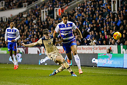 Nick Blackman of Reading is tackled by Sam Byram of Leeds United - Photo mandatory by-line: Rogan Thomson/JMP - 07966 386802 - 10/02/2015 - SPORT - FOOTBALL - Reading, England - Madejski Stadium - Reading v Leeds United - Sky Bet Championship.
