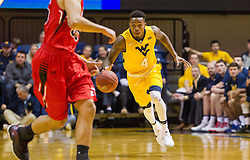 Dec 10, 2016; Morgantown, WV, USA; West Virginia Mountaineers guard Daxter Miles Jr. (4) dribbles up the floor during the first half against the Virginia Military Keydets at WVU Coliseum. Mandatory Credit: Ben Queen-USA TODAY Sports