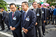 21 AUGUST 2014 - BANGKOK, THAILAND:  Lt-Gen THARNCHAIYANT SRISUWAN (left), and Lt-Gen PHISIT SITTHISARN, both of the Royal Thai Army and members of the National Legislative Assembly (NLA) wait with other members of the NLA for their group picture to be made before meeting to select a new Prime Minister. The Thai National Legislative Assembly (NLA) met Thursday at the Parlimanet Building in Bangkok to select a new Prime Minster. The NLA was hand selected by the Thai junta, formally called the National Council for Peace and Order (NCPO), and is supposed to guide Thailand back to civilian rule after a military coup overthrew the elected government in May. The NLA unanimously selected General Prayuth Chan-ocha, commander of the Thai Armed Forces and leader of the coup in May that deposed the elected civilian government, as Prime Minister. Prayuth is Thailand's 29th Prime Minister since the 1932 coup that created Thailand's constitutional monarchy.       PHOTO BY JACK KURTZ
