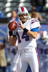 Oct 16, 2011; East Rutherford, NJ, USA; Buffalo Bills quarterback Ryan Fitzpatrick (14) warms up before the game against the New York Giants at MetLife Stadium. New York defeated Buffalo 27-24. Mandatory Credit: Jason O. Watson-US PRESSWIRE