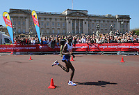 Mo Farah of Great Britain passes Buckingham Palace and the Victoria Memorial as they approach the finish of the Virgin Money London Marathon 2014<br /> on Sunday 13 April 2014<br /> Photo: Dave Shopland/Virgin Money London Marathon<br /> media@london-marathon.co.uk
