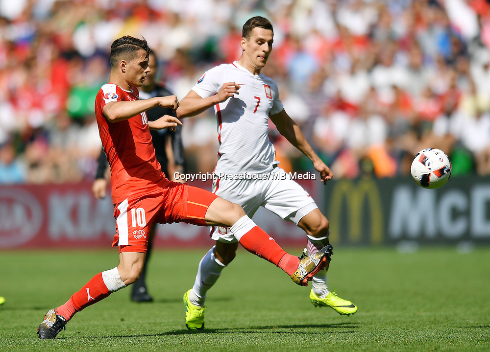 2016.06.25 Saint-Etienne<br /> Pilka nozna Euro 2016<br /> mecz 1/8 finalu Szwajcaria - Polska<br /> N/z Granit Xhaka Arkadiusz Milik<br /> Foto Lukasz Laskowski / PressFocus<br /> <br /> 2016.06.25<br /> Football UEFA Euro 2016 <br /> Round of 16 game between Switzerland and Poland<br /> Granit Xhaka Arkadiusz Milik<br /> Credit: Lukasz Laskowski / PressFocus