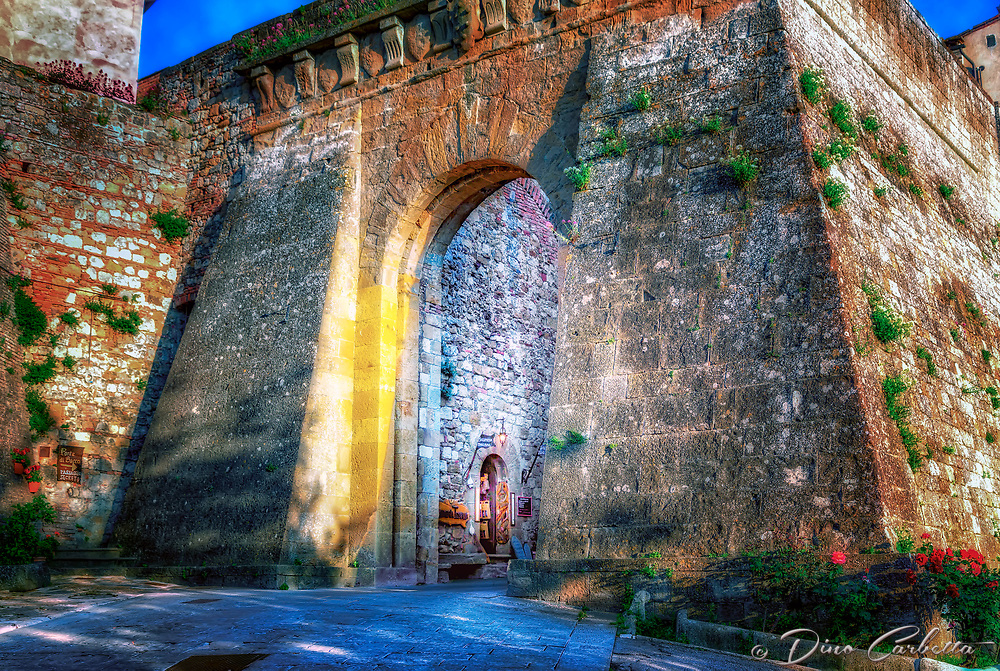 """""""Entrance to the Etruscan bastion in Montepulciano""""...<br /> <br /> Within its ancient ramparts are elegant Renaissance palaces, ancient churches, charming squares, hidden corners, and vast panoramas of the famous vineyard valleys of the Val d'Orcia. Montepulciano has received great attention following the filming of the sequel Twilight - New Moon.  I would love to spend more time in the picturesque town, and will include a longer stay in my return to Italy.  Montepulciano is famous for not just one but two excellent wines, Vino Nobile di Montepulciano and Rosso di Montepulciano. However, it is often underestimated in terms of the interest of its art and architecture, perhaps because of its small size.  One of the many promises I made to myself upon my return home was to drink a glass of my favorite Italian wine nightly, and without doubt...Montepulciano is my favorite wine region."""