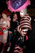 Izshe Anybodi. and Simon Rose . 25th anniversary party and fashion show by Agent Provocateur at the Cafe de Paris, Coventry Street, London W1 on 14th February 2005.ONE TIME USE ONLY - DO NOT ARCHIVE  © Copyright Photograph by Dafydd Jones 66 Stockwell Park Rd. London SW9 0DA Tel 020 7733 0108 www.dafjones.com