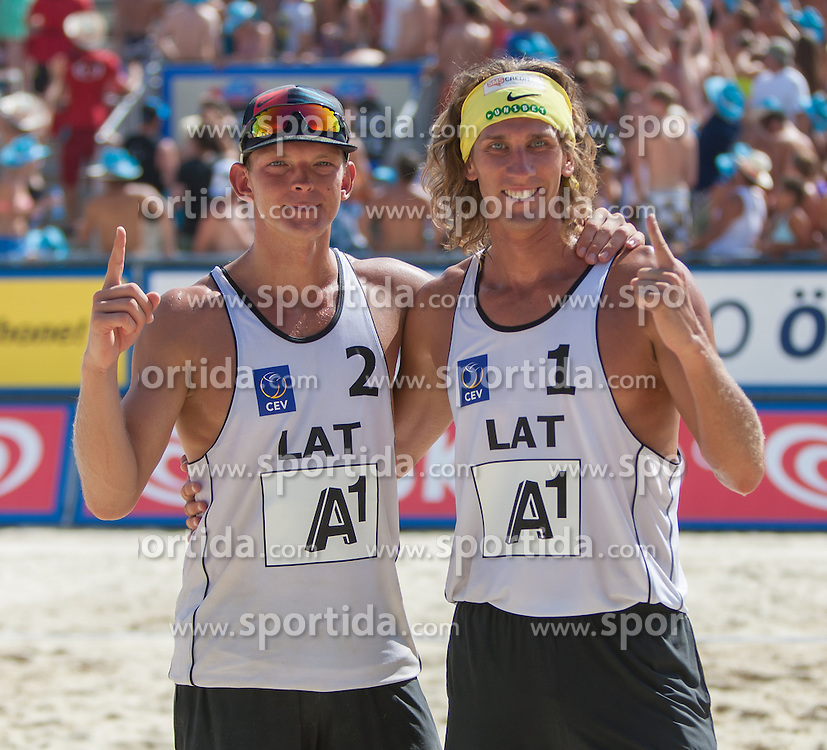 04.08.2013, Klagenfurt, Strandbad, AUT, A1 Beachvolleyball EM 2013, Halbfinale Herren, Spiel 69, im Bild Grzegorz FIJALEK 2 POL Mariusz PRUDEL 1 POL // during mens seminfinals match 69 of the A1 Beachvolleyball European Championship at the Strandbad Klagenfurt, Austria on 2013/08/04. EXPA Pictures © 2013, EXPA Pictures © 2013, PhotoCredit: EXPA/ Mag. Gert Steinthaler