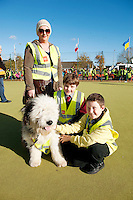 Entitled 'Hi- Five 4 Hi Vis'  A Guinness World Record for the greatest number of people wearing high visibility vests in any one place took  place in Oranmore town centre at the all weather pitch The event was supported by the Garda Siochana and the Road Safety Authority..At the event were hundreds of highly visible Lorraine and Ben McHugh with Tom Delaney (centre) and Spud the dog. Picture :Andrew Downes.