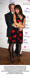 Model LISA BARBUSCIA and MR ANTON BILTON at a party in London on 3rd February 2004.PRI 6