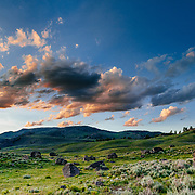 The clouds light up as the sun sets over the Lamar Valley of Yellowstone National Park, Wyoming