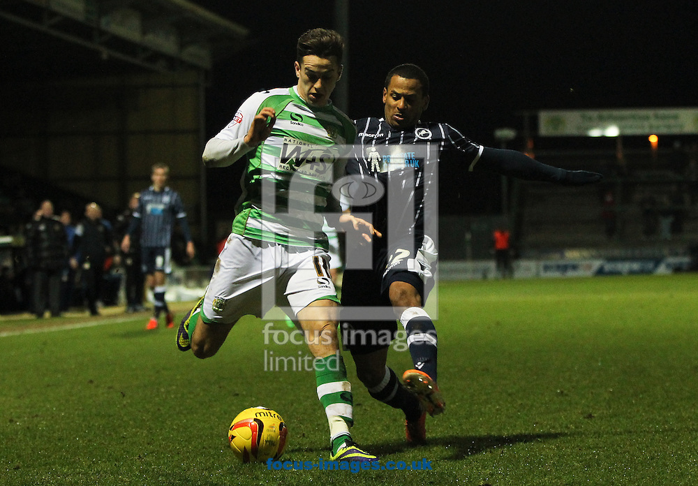 Tom Lawrence (left) of Yeovil Town gets tackled by DJ Campbell (right) of Millwall during the Sky Bet Championship match at Huish Park, Yeovil<br /> Picture by Tom Smith/Focus Images Ltd 07545141164<br /> 11/02/2014