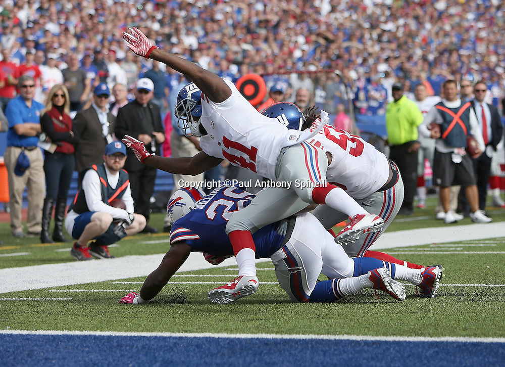 New York Giants cornerback Dominique Rodgers-Cromartie (41) and New York Giants outside linebacker J.T. Thomas (55) stop for no gain a fourth down pass caught by Buffalo Bills running back Karlos Williams (29) with goal to go from the Giants one yard line during the 2015 NFL week 4 regular season football game against the Buffalo Bills on Sunday, Oct. 4, 2015 in Orchard Park, N.Y. The Giants won the game 24-10. (©Paul Anthony Spinelli)