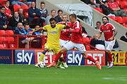 Battle of the 17's AFC Wimbledon striker Andy Barcham (17) and Charlton Athletic defender Fredrik Ulvestad (17) during the EFL Sky Bet League 1 match between Charlton Athletic and AFC Wimbledon at The Valley, London, England on 17 September 2016. Photo by Stuart Butcher.