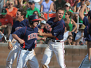 Milton runner Andrew Wood (4) celebrates with Sean Ryan Brophy, left, and Erik Petersen after he scores the go-ahead run in the eighth inning against Roswell in their GHSA AAAAAA State Baseball Championship game, Monday, May 27, 2013, in Milton, Ga.   David Tulis/dtulis@gmail.com