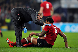 Courtney Lawes of England is treated for an injury - Photo mandatory by-line: Patrick Khachfe/JMP - Mobile: 07966 386802 22/11/2014 - SPORT - RUGBY UNION - London - Twickenham Stadium - England v Samoa - QBE Internationals