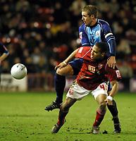 Photo: Dave Linney.<br />Walsall v Barnsley. The FA Cup. 17/01/2006. <br />Barnsley's Paul Reid (L) climbs over Kevin James to claim the ball.