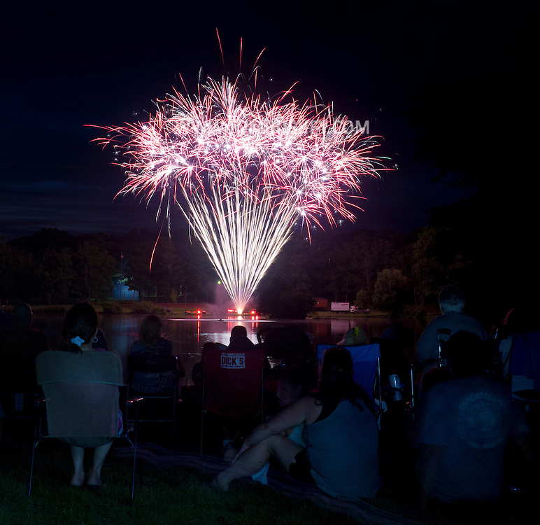 Middletown, New York  - People watch the fireworks display by the lake at Fancher-Davidge Park duiring Middletown's Stars and Stripes Celebration on June 28, 2014.