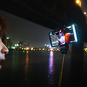 Nai Nai, a 23-year-old live-streamer in Shanghai, China, live-streams in Wuhan city. 