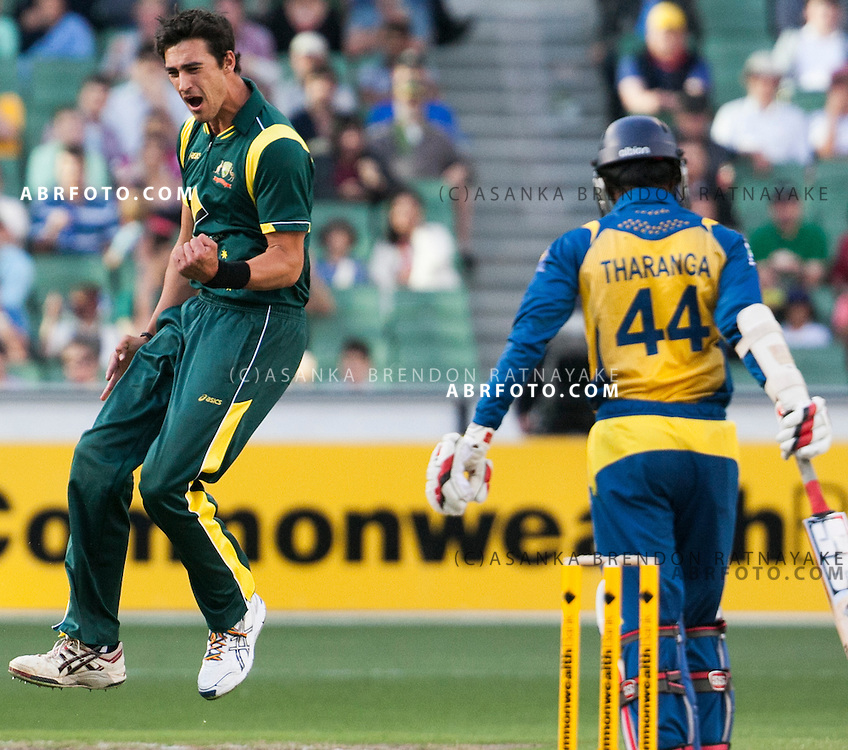 Mitchell Starc jumps in celebration after getting the wicket of Upul Tharanga during game 1 of the Commonwealth Bank Series Australia v Sri Lanka played at the Melbourne Cricket Ground in Melbourne,Victoria, Australia. Photo Asanka Brendon Ratnayake