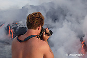 "videographer Shane Turpin, films lava pouring into the ocean from Kilauea Volcano, Hawaii Island ("" the Big Island ""), Hawaii, U.S.A. ( Central Pacific Ocean ) MR 352"