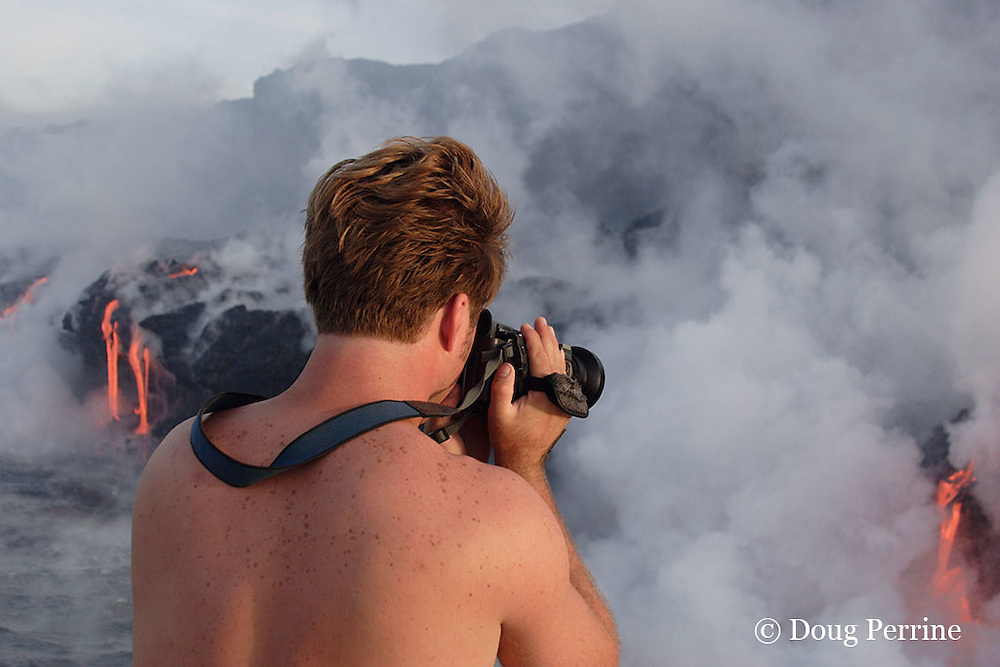 """videographer Shane Turpin, films lava pouring into the ocean from Kilauea Volcano, Hawaii Island ("""" the Big Island """"), Hawaii, U.S.A. ( Central Pacific Ocean ) MR 352"""