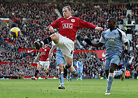 Photo: Paul Thomas.<br /> Manchester United v Manchester City. The Barclays Premiership. 09/12/2006.<br /> <br /> Wayne Rooney (L) of Man Utd can't be stopped by of Micah Richards Man City from shooting at goal.