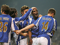 Photo: Lee Earle.<br /> Portsmouth v Sheffield United. The Barclays Premiership. 23/12/2006. Portsmouth's Noe Pamarot (2ndR) is congratulated after scoring their third.