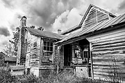 An old house full of character, now lies abandoned.