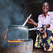 CAPTION: Thanks to the money Fatima has been able to save on fuel during the four years that she been using an improved cookstove, she is now able to replace the thatched roof of her home with iron sheets. Soon, she even hopes to build a new house. LOCATION: Chinsapo 2, Lilongwe, Malawi. INDIVIDUAL(S) PHOTOGRAPHED: Fatima Amadu.