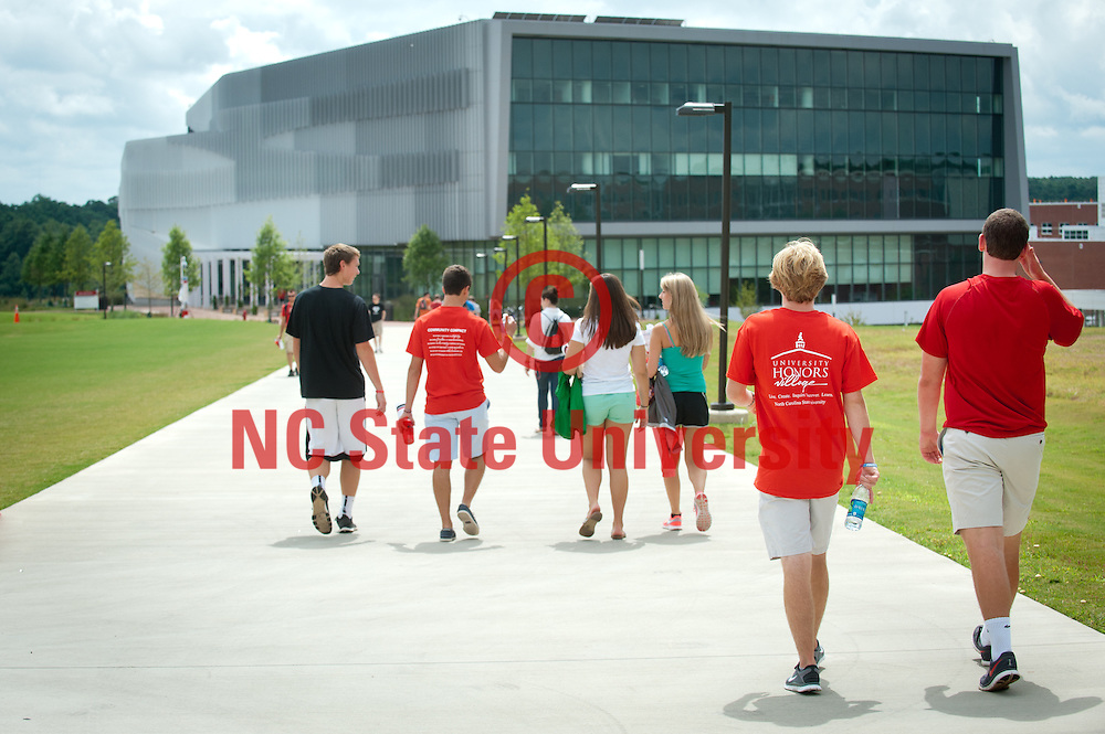 Students walk towards the Hunt Library on Centennial Campus.