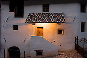 Whitewashed render of a rural farmhouse in Steinegger, Eppan-Appiano in South Tyrol, Italy.
