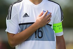 WREXHAM, WALES - Thursday, August 15, 2019: Cyprus' captain Giorgos Kondylis places his hand over the badge on his shirt as he sings the national anthem before the UEFA Under-15's Development Tournament match between Cyprus and Malta at Colliers Park. (Pic by Paul Greenwood/Propaganda)