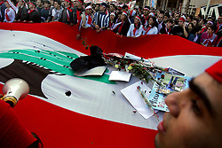 Several thousand Lebanese gather at the scene of the bombing that killed former Prime Minister Rafik Hariri, afterward they walked to his grave, Beirut, Lebanon, Feb. 21, 2005. The crowd demanded a Syrian pullout and an international probe into the assassination.